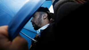 Dappy used a blue umbrella to hide is face as he entered court.