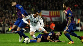Spain midfielder Sergio Busquets tackles Cristiano Ronaldo in the Copa del Rey.