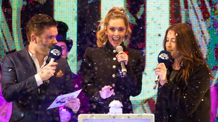 X Factor judge Cheryl Fernandez-Versini with Lisa Snowdon and Dave Berry during the switch on for this year's Oxford Street Christmas lights.