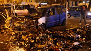 Rubbish was strewn on the ground around the written-off vehicles after fiery crashes in the Belgian capital.