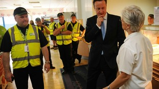 Prime Minister David Cameron meets workers at an Asda Distribution Centre in Dartford, Kent