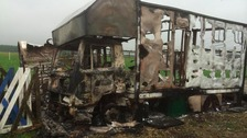 Photo of burnt-out wreckage
