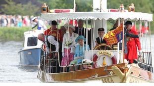 The Queen and Duke of Edinburgh aboard a passenger steamer