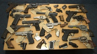 A selection of firearms and imitation weapons