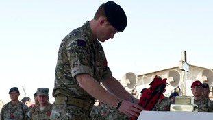 In pictures: Prince Harry joins Remembrance service with troops in Afghanistan