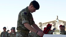 Prince Harry attends Remembrance service with troops in Afghanistan