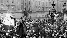 Civilians and servicemen celebrate the Armistice announcement, ending the First World War on November 11, 1918.