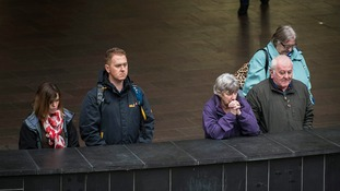 Shoppers at Cabot Circus shopping centre in Bristol pause to pay their respects during the two minute silence at 11am