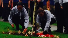 Students laid wreathes and planted crosses in memory of the former student.