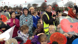 Children and staff held poppies to commemorate 100 years since WW1