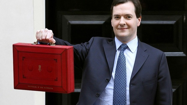 Chancellor of the Exchequer George Osborne holding up his red Ministerial Box outside 11 Downing Street on budget day