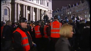 Police evicting people from the Occupy St Pauls camp in London