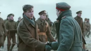 The British and German soldiers meeting in No Man's Land.