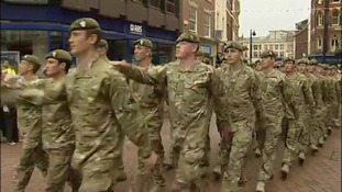 Soldiers march through the streets of Derby for homecoming parade