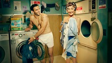 Wearing curlers and not much else, June Brown joins Davood Ghadami in the laundrette.