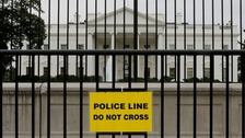 White House is seen through layers of fencing the security breach.