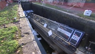 Canal boat stuck in a lock in Widcombe in Bath