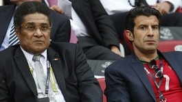 Former players Eusebio, left, and Luis Figo sit in the Warsaw stands.