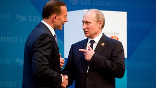 Vladimir Putin and Australian PM Tony Abbott speaking at today's G20 summit.