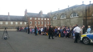 Crowds await the Queen's arrival at Hillsborough Castle in Northern Ireland.
