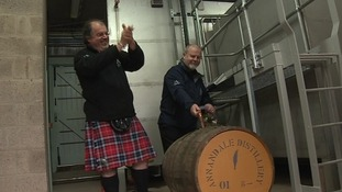Co-owner David Thomson cheers as the first cask is filled.
