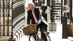 Andrew Mitchell arriving for a Cabinet meeting at No 10 Downing Street on his bicycle