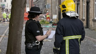 Emergency services at the scene of a suspected gas explosion in the Shaw area of Oldham