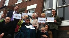 Photo of residents of Alveston in Derbyshire, campaigning against a huge phone mast erected close to their home