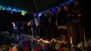 Friends gathered for a candlelit vigil tonight to pay tribute to 19 year old Max Lewis