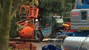 Picture showing what's thought to be a cherry picker lying on its side