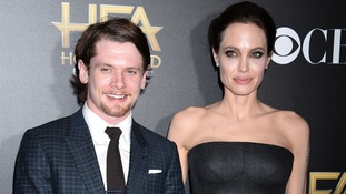 Jack O'Connell pictured with Angelina Jolie at The Hollywood Film Awards 2014