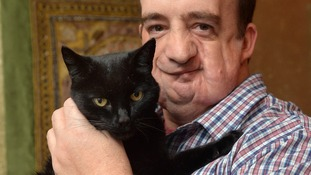 Together again: Cat owner reunited with beloved pet after 10 years of searching