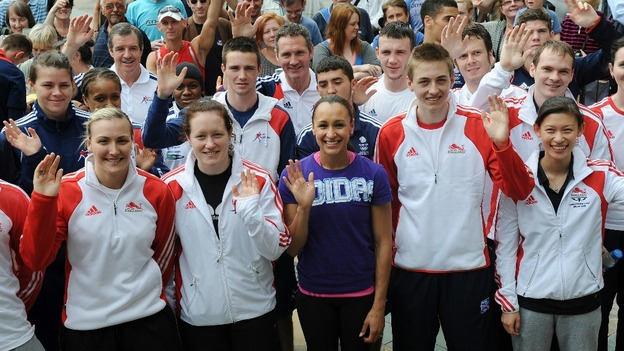 Jessica Ennis (centre) with fellow Olympic athletes in Sheffield city centre ahead of the London 2012 Olympic Games