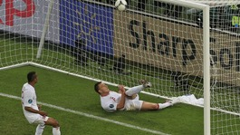 England defender John Terry clears the ball against Ukraine.