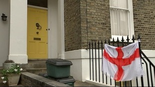 The flag of England, the St George's Cross, flaps in the wind after being tied to Emily Thornberry's house.