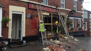 Hole left in the front of the Rising Sun following lorry crash