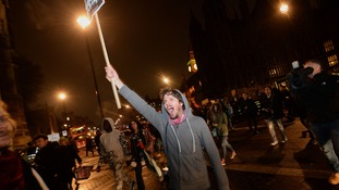 A demonstrator shouts as the Occupy London movement head to Parliament Square.