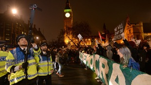 Protesters from the Occupy group attempt to stop traffic in Parliament Square.