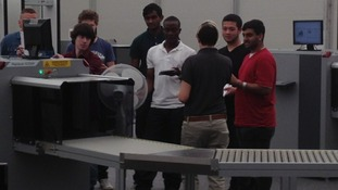 New recruits learn how to operate security scanners