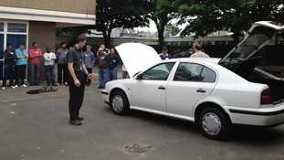 Recruits watch a demo of searching a car