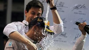 World Champion Lewis Hamilton Mercedes AMG F1 celebrates on the podium with Toto Wolff.