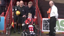 Oskar Pycroft leads out the team at Ashton Gate