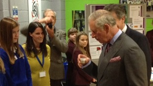 Prince Charles samples a milkshake - part of a competition sponsored by Dairy Crest to interest local schoolchildren in creating new products