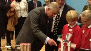 Prince Charles takes a close look at a school engineering project