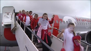 Children disembarking Jubilee plane