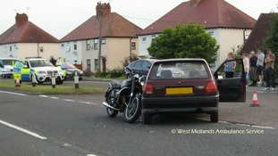 Police at scene of motorcycle-car collision in Norton, Worcestershire