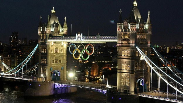 The Olympic rings are lit below Tower Bridge to mark the one month countdown to the Olympic Games