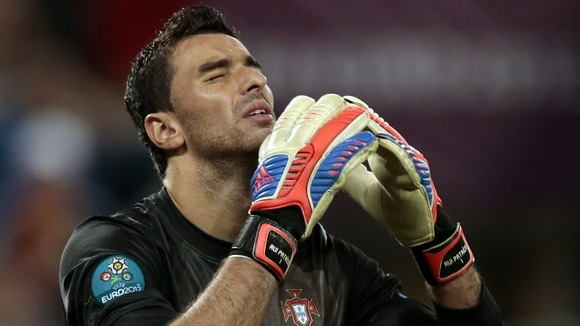 Portugal goalkeeper Rui Patricio looks dejected after losing on penalties.