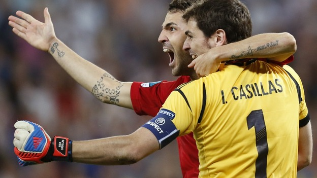 Spain midfielder Cesc Fabregas celebrates with Iker Casillas.