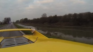 Teenage wakeboard champ Jorge Gill towed by Ferrari F50 along Lincolnshire river